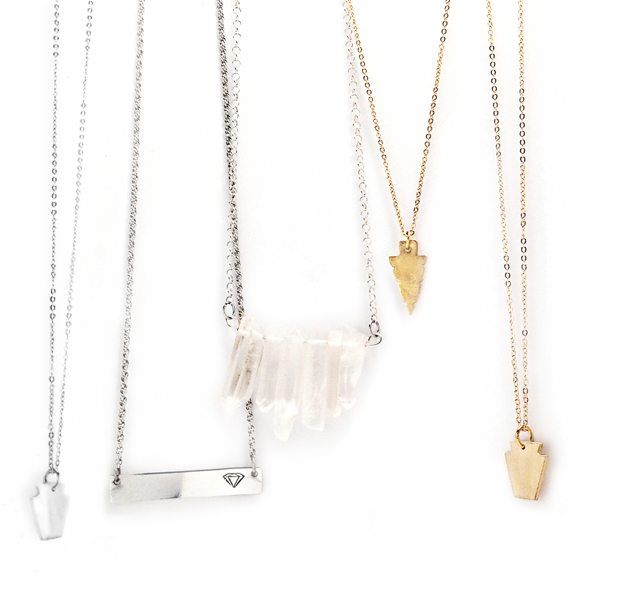 frost finery necklaces hanging on white background